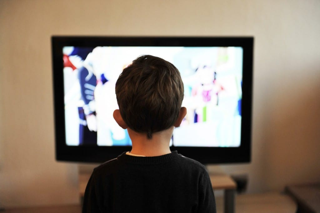 child watching a show from an IPTV subscription